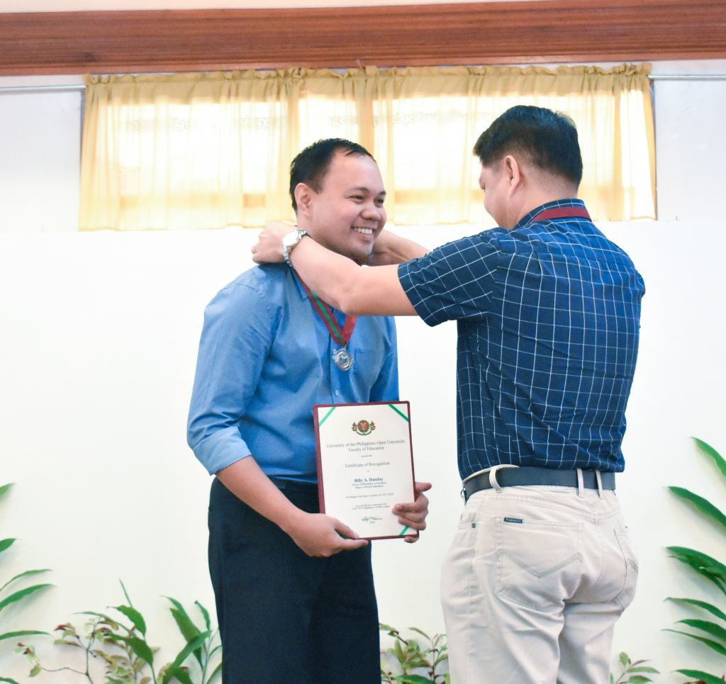 PhD in Education (Major in Physics Education) graduate Billy A. Danday receives recognition for leading the A.Y. 2017–2018 UPOU FEd graduates. Mr. Danday is also the sole Dean's Lister among his fellow UPOU FEd graduates.