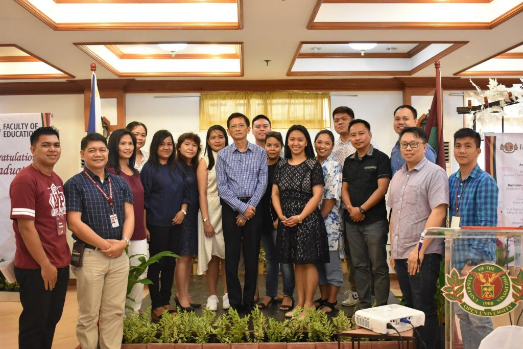Newly appointed FEd Faculty Office Alumni Chapter Officers with Dean Bagarinao (second from the left) and UPOU AFI representatives (first from the left and from the right).